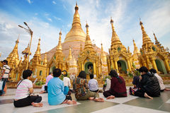 Buddhist devotees praying at the full moon festiv Stock Photos