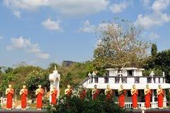Buddhist Disciple statues at a temple in Sri Lanka Stock Photos