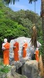 Buddhist Disciple statues at a temple in Sri Lanka. Statues of Buddhist Monks at the Rock Temple Dambulla, Sri Lanka Royalty Free Stock Images
