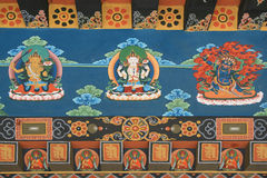 Buddhist divinities and diverse patterns are painted on a wall of a temple (Bhutan) Royalty Free Stock Photos