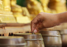Buddhist donate money Stock Photo