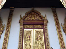 Buddhist doors. The doors of a buddhist temple in Chiang Mai, Thailand royalty free stock photo