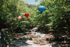 Buddhist Festival. Lanterns hanging on the way to a Buddhist temple Stock Photos