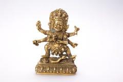 Buddhist figure with patina Stock Photography