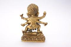 Buddhist figure with patina Stock Photos