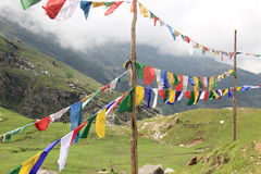Buddhist flag fluttering. Buddhist flags waving in the wind in the mountains Stock Photo