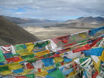 Buddhist flags. Buddhist flag on a background of mountains Royalty Free Stock Photo