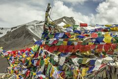 Buddhist flags with mantras on the mountain snow mountain top. Ladakh, Jammu and Kashmir/India - 26.07.2018. Buddhist flags with mantras on the mountain snow stock images