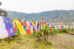 Buddhist flags at sacred lake Royalty Free Stock Image