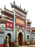 Buddhist gateway. Well-decorated acient Buddhist gateway of a temple Royalty Free Stock Photo