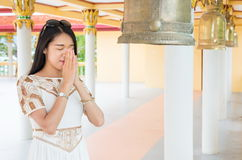 Buddhist girl praying inside the temple Royalty Free Stock Photography