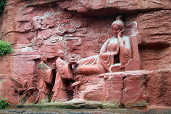 Buddhist goddes. Near the wall of rock in Emei SDhan, China Royalty Free Stock Image