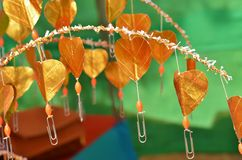 Buddhist golden money tree with hearts instead of leaves and paper clips for banknotes Royalty Free Stock Photography