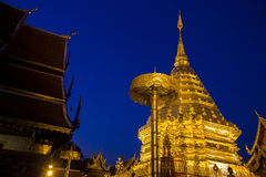 Buddhist golden pagoda in night time at Doi Suthep temple Stock Photo