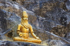 Buddhist golden statue man meditating Stock Image