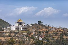 Buddhist guest house in Nepal. The big Buddhist guest house for pilgrims made in the form of the monastery, in the settlement, on one of hills in Kathmandu Royalty Free Stock Image