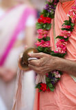 Buddhist hands with bells Royalty Free Stock Image
