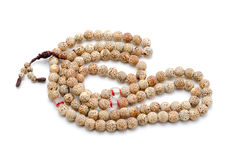 Buddhist or Hindu prayer beads isolated on white. Stock Image