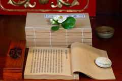 Buddhist or Hindu prayer beads,scripture. The ancient classic books and Incense and flowers Stock Photos