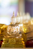 Buddhist idol made by glass for offering Stock Photos