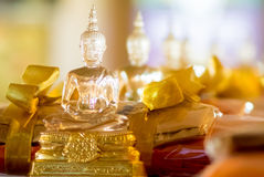 Buddhist idol made by glass for offering Stock Photo