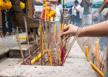 Buddhist incense and candle Royalty Free Stock Photos