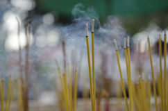 Buddhist incense smoke in a temple Royalty Free Stock Photo