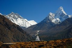 Buddhist Khumjung Stupa, Lhotse Peak and Ama Dablam Peak in Nepa. L, Sagarmatha Area Royalty Free Stock Photos