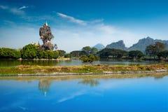 Buddhist Kyauk Kalap Pagoda. Hpa-An, Myanmar (Burma). Amazing Buddhist Kyauk Kalap Pagoda under blue sky. Hpa-An, Myanmar (Burma) travel landscapes and stock photography