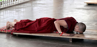 Buddhist lama. Praying at dalai lama temple in macloadganj, himachal pradesh india Royalty Free Stock Images