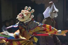 Buddhist lama in the mask White Mahakala performs Dance Mask at the festival in the monastery. Stock Images