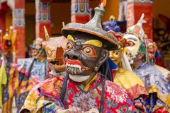 Buddhist lamas dressed in mystical mask dancing Tsam mystery dance in time of Yuru Kabgyat Buddhist festival at Lamayuru Gompa, La. LAMAYURU, INDIA - JUNE 13 Royalty Free Stock Photos