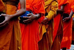 Buddhist Lent  concept using :  Monks in robes collecting alms Stock Photography