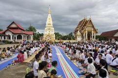 Buddhist lent. NAWA, NAKHONPHANOM,THAILAND - 2014-07-11 : Unidentified Buddhists are in activities of Buddhist Lent festival on July 11, 2014 at Wat PaThatPhasit Royalty Free Stock Photo