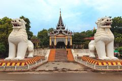 Buddhist lion statues. Guarding the entrance of the Mandalay hill in Myanmar (Burma royalty free stock image