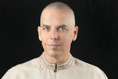 Buddhist Looks To Camera Stock Photo
