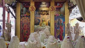 Buddhist are make offerings garlands of jasmine with the Luang Por Tan Jai buddha at Wat Phra That Doi Kham temple, Chiang Mai