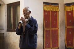 Kathmandu, Nepal, Buddhist Man at Bouddhanath Temple Royalty Free Stock Photos