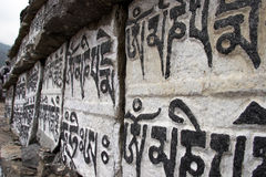 Buddhist mani prayer stones, Himalaya, Nepal Royalty Free Stock Images