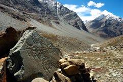BUDDHIST MANI STONES. Mani stones on the trail from Darcha to Padum, Zanskar valley, Ladakh, India Royalty Free Stock Images