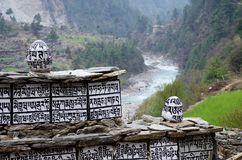 Buddhist mani stones near Dudh Kosi river,Nepal. Ancient buddhist mani stones with sacred mantras near Dudh Kosi river,Eastern Nepal, Everest region Royalty Free Stock Image