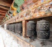 Buddhist many prayer wheels, buddhism in Nepal. View of buddhist many prayer wheels, buddhism in Nepal Royalty Free Stock Photo