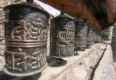 Buddhist many prayer wheels Stock Photography