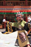 Buddhist mask dancer with traditional dress In Ladakh. Royalty Free Stock Image