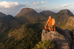 Buddhist master monk meditating in mountains Stock Photography