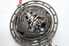 Buddhist medallion Charm Stock Image