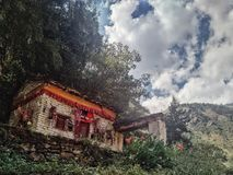buddhist monastery building with prayer flags flowers royalty free stock photos