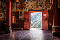 Buddhist monastery in the middle of the mountain. Buddhist monastery interior with an open door to the mountains Royalty Free Stock Images