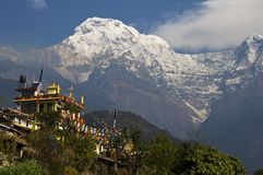 Buddhist monastery and snowy mountains. Trekking to Annapurna Ba. Se Camp, Nepal stock images