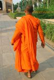 Buddhist monk. Dressed in orange walking to temple Royalty Free Stock Image